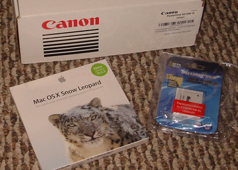 Canon camera box, Snow Leopard package, spare battery