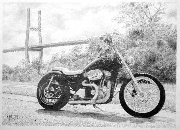 Harley-Davidson motorcycle in front of bridge